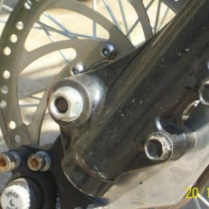 Picture of bracket made to adapt caliper to bolt to Kawasaki front fork.